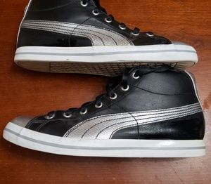 Black and silver Puma high tops
